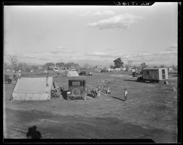 """Dust Bowl families paid 50 cents a week to stay at this auto camp north of Calipatria, Calif. (1937). Steinbeck writes: """"Because they were lonely and perplexed, because they had all come from a place of sadness and worry and defeat, and because they were all going to a new mysterious place, they huddled together ... they shared their lives ... and the things they hoped for in the new country."""""""