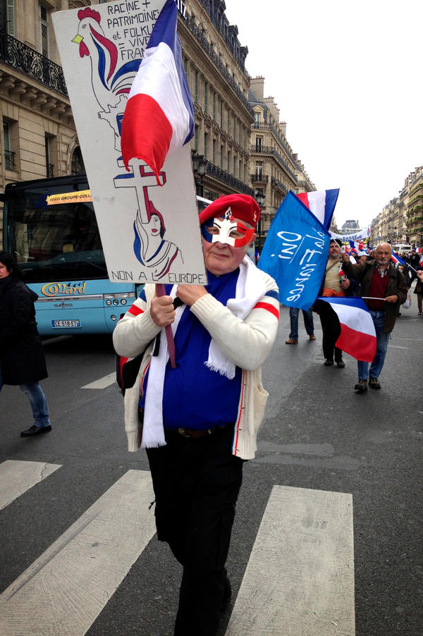 Marchers carried flags and banners during a rally for France's far-right National Front party.