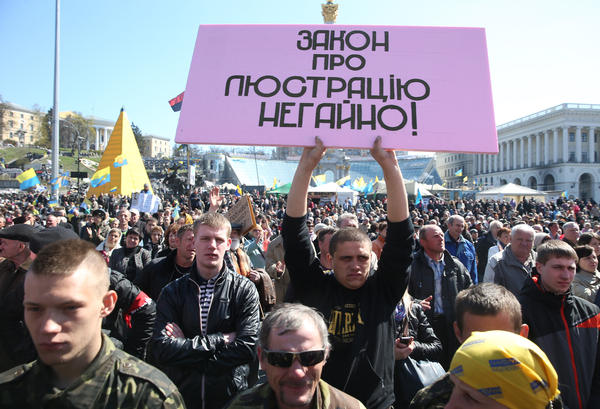 "Ukrainian activists stage a rally in Kiev's Independence Square on April 6. The slogan reads: ""Law on lustration [or cleansing, of the political and business elites] now!"""