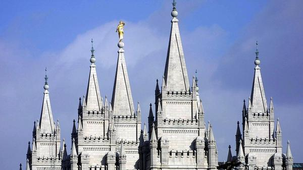 Spires from the Mormon temple in downtown Salt Lake City reach to the sky.