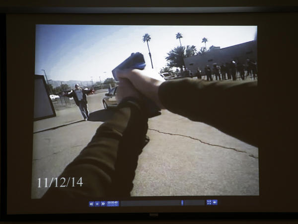 Footage from a Las Vegas Police Department body camera demonstration is projected on a screen in November.