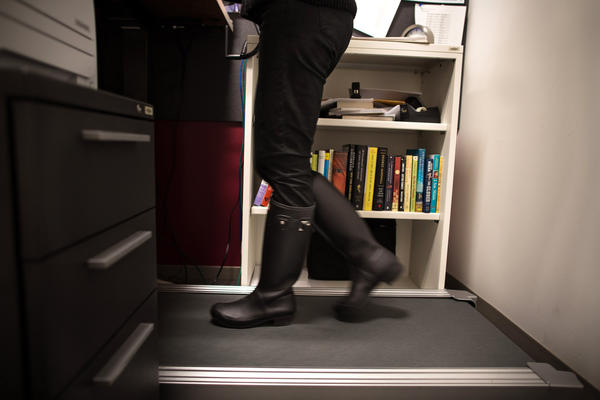 NPR senior Washington editor Beth Donovan walks on a treadmill desk in her office in Washington, D.C.