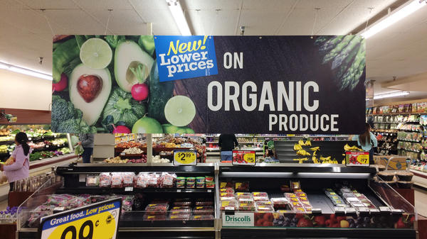 "Produce is often accompanied by signs like this one at a King Soopers grocery store in Fort Collins, Colo. But customers are often confused by their meaning, which is one reason the Organic Trade Association is trying to raise money for a ""checkoff"" to pay for consumer advertising and research."
