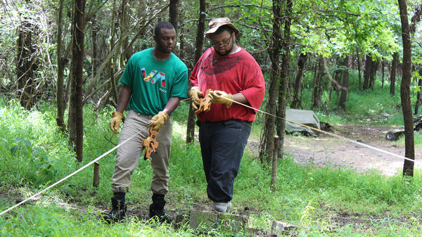 Kalen Gilliam (left) and Justis Jackson take measurements at the Urban Archaeology Corps excavation site about 10 miles outside Richmond, Va.