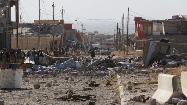 A scene of the extensive damage in the northern Iraqi town of Sinjar. Kurdish fighters entered the town Friday and raised their flag after driving out the Islamic State fighters who overran it last year.