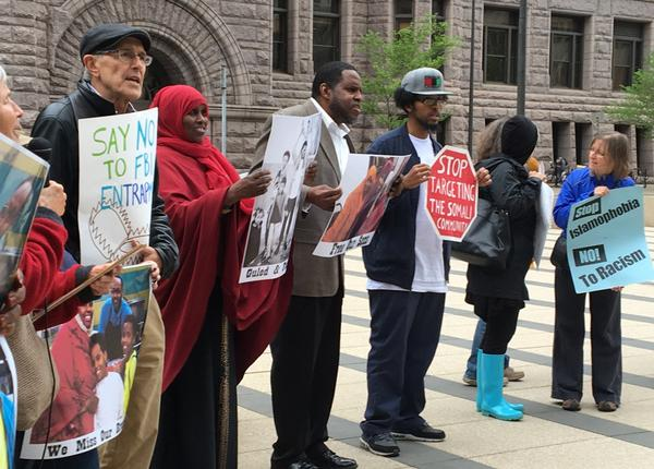 Protesters gathered outside the federal courthouse in Minneapolis where three young Somali-Americans are on trial for allegedly planning to go to Syria to join the Islamic State. The demonstrators say the FBI and local law enforcement is targeting and entrapping Somali-Americans in terrorism cases. Six men have already pleaded guilty.