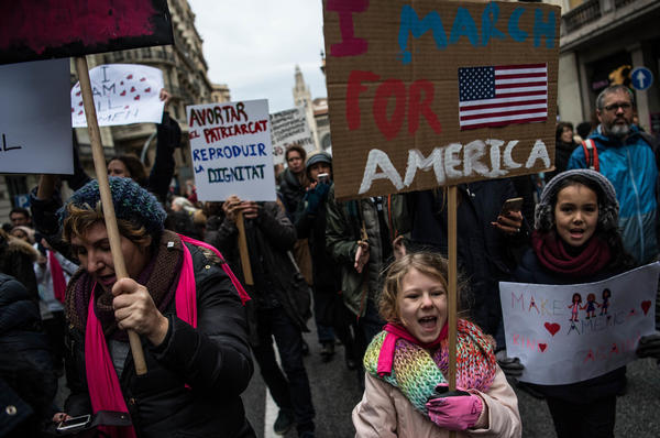 Demonstrators bear their signs at the women's march in Barcelona, Spain. The Spaniards drew inspiration from the Women's March on Washington, but due to the time difference, they actually hit the streets before the Americans.