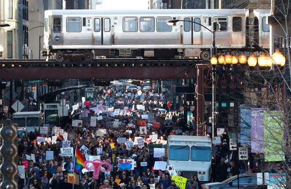 Protesters make their way through Chicago during the city's women's march.