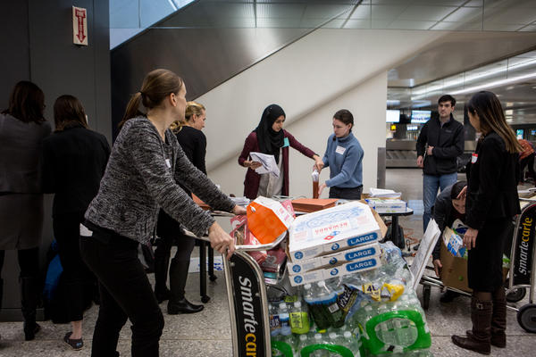 Volunteer attorneys at Washington Dulles International Airport in D.C. set up a temporary workstation near the baggage claim.