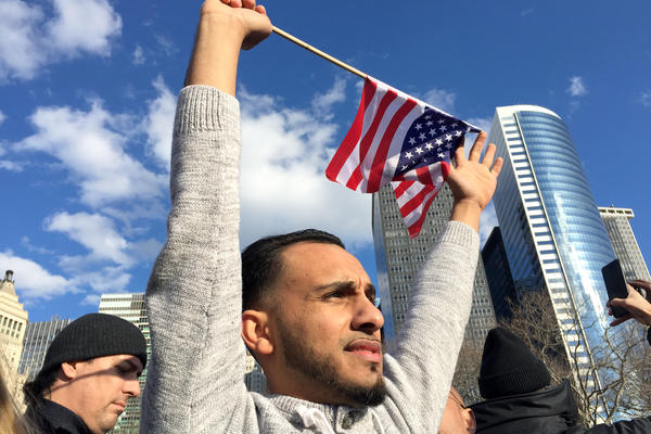 Salah Alsaidi protests at Battery Park in New York City. His mother is a green card holder from Yemen.