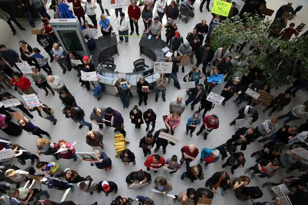 By 1 p.m. Sunday, roughly 300 people had gathered at Sacramento International Airport in northern California to protest Trump's executive order on immigration.