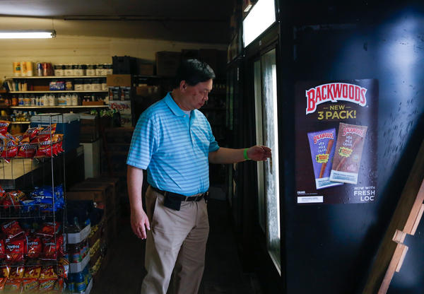 Kim Ma grocery store used to be owned by Raymond Wong's (pictured) parents. He grew up there — literally. His family lived in the back of the store.