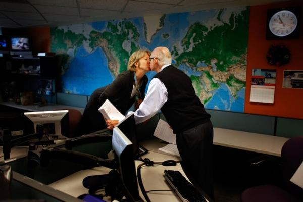 Fellow newscaster Jean Cochran gives Kasell a kiss at 10:55 a.m., moments before he delivered his final newscast.