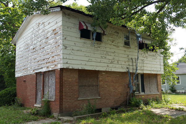 Abandoned and in shocking disrepair, NPR Correspondent Cheryl Corley's childhood home in Harvey is among many boarded and dilapidated properties now littering the suburb south of Chicago.