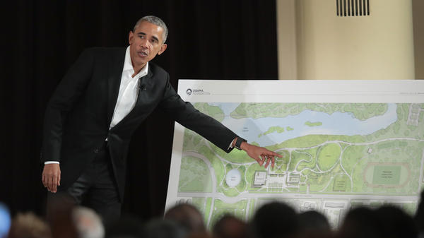 At a ceremony last May, former President Obama points out features of his proposed presidential center, which is scheduled to be built in Chicago. It is not the only honor that awaits the former president in the state he served as a senator: He's also getting a day designated in his honor.
