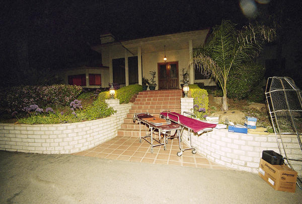 Gurneys to remove bodies from the Heaven's Gate cult house are shown in front of the house in the 9,200 sq.-foot mansion in the Rancho Santa Fe gated community in San Diego, Calif., March 27, 1997.