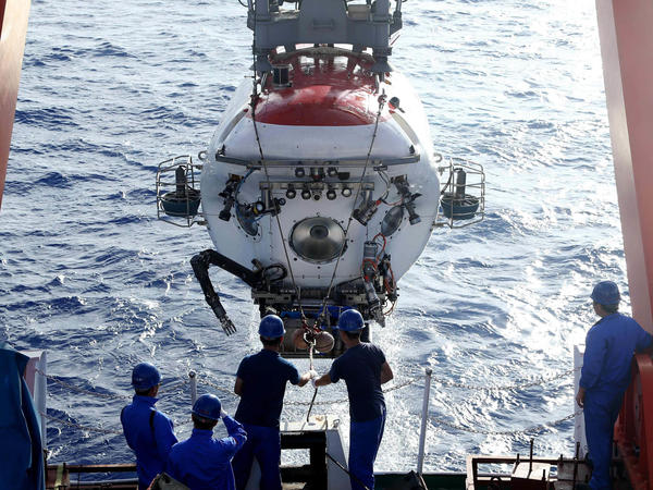 Jiaolong, China's manned submersible, is retrieved after its dive in the Mariana Trench on June 1, 2017, after its 20th dive in the world's deepest known trench since 2012.