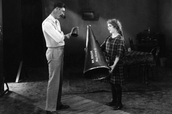 Pickford and director William Beaudine pose on the set of 1925's <em>Little Annie Rooney</em>. According to scholar Cari Beauchamp, if Pickford clashed with her director, she was careful to criticize him in private, and not on the set.