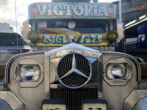 A jeepney adorned with eye-catching lettering sits parked in at a gas station in Calamba, Leguna, about an hour south of the capital Manila. Jeepneys often sport a name, phrase or symbol important to their driver.