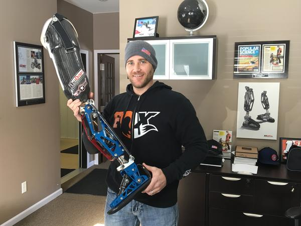 U.S. Paralympic snowboarder and inventor Mike Schultz in his St. Cloud, Minn., office, showing off the prosthetic sports leg he invented in 2009. The Moto Knee costs about $6,000; the Versa Foot is around $2,400. It's estimated 30 athletes will use the devices at the Paralympics in South Korea.