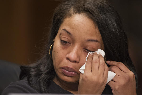 Kubiiki P. wipes tears as she testifies at a 2017 Senate hearing about her young daughter being sold for sex on Backpage.com. The site, ostensibly for classifieds, is well-known for its adult-services ads.