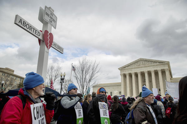 "Anti-abortion activists converge in front of the Supreme Court last year during the annual ""March for Life."""