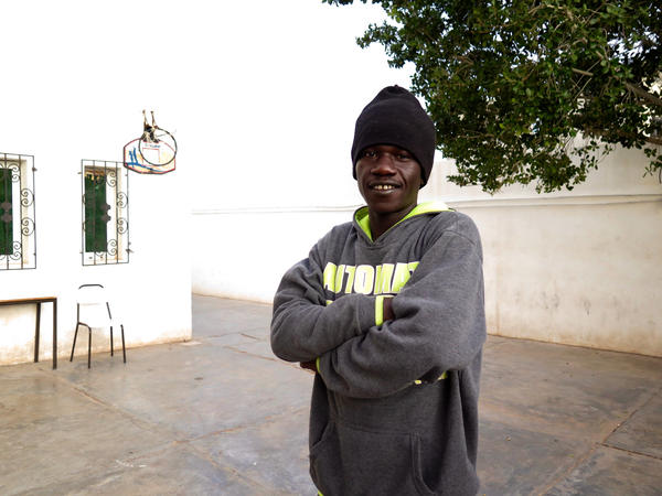 """Boubaker Nassou describes the prisons where he was held in Libya as """"slave markets."""" He was repeatedly bought and sold into and out of these prisons before being taken into bonded labour. Now he lives in a shelter run by the Tunisian Red Crescent."""
