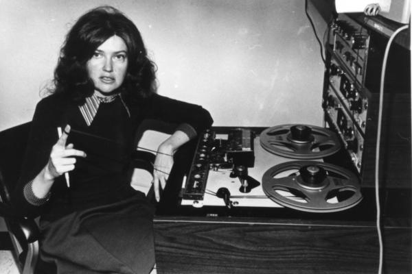 """In this 1972 archival photo, host Linda Wertheimer holds a grease pencil to mark audio tape for editing. The term """"blading"""" refers to when cuts to tape were made manually via razor blade."""