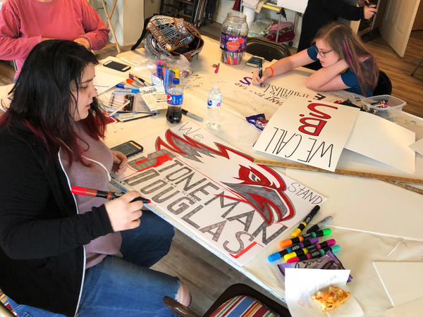 On March 18, Marshall County High School freshman Lela Free (left) works on a sign for the March for our Lives rally her community is planning for this Saturday. Free survived a shooting at her school in January, but was moved to action by the shooting in Parkland, Fla., on Feb. 14.