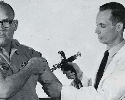 "In this 1971 Army photo, a service member is vaccinated with a jet injection gun. The Army at the time called the gun ""a fast, safe method for giving mass inoculations to troops."""