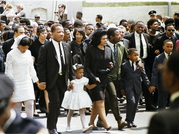The family of slain civil rights leader Martin Luther King Jr., walk in the funeral procession in Atlanta on April 9, 1968. From left: daughter Yolanda, 12; King's brother A.D. King; daughter Bernice, 5; widow Coretta Scott King; Rev. Ralph Abernathy; sons Dexter, 7, and Martin Luther King III, 10.