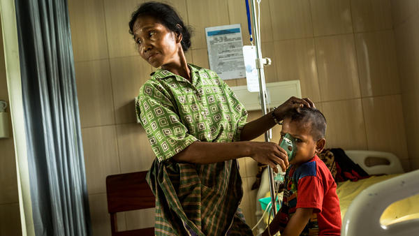 A mother tends to her child, who has pneumonia, in the pediatric ward of Karitas Hospital in Waitabula, a small town on Sumba Island.