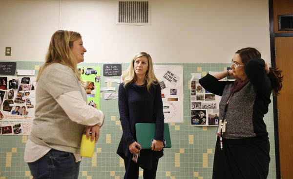 Teachers Sarah Lindenberg and Kara Cisco chat with Kelly Brown, the BARR coordinator at St. Louis Park.