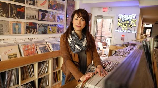 Talia Schlanger in the record stacks.