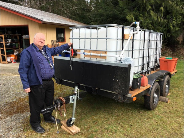 Jim Buck of Joyce, Washington, shows off the community's portable water filtration unit for use in case of a major earthquake.