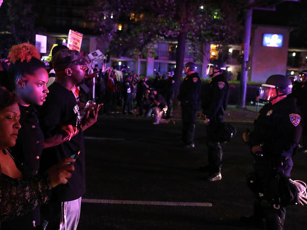 Black Lives Matter activists in Sacramento gathered on Friday to protest the death of Stephon Clark, an unarmed black man who was fatally wounded by police. At a vigil for Clark the next day, a woman was hit by a vehicle.