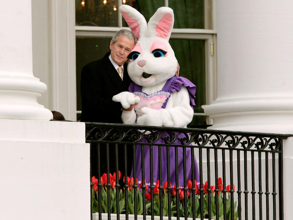 President George W. Bush pauses to embrace a person dressed as the Easter Bunny during the Easter Egg Roll in 2008.
