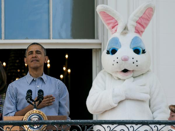 President Obama, and the Easter Bunny, stand during the National Anthem at the 2014 White House Easter Egg Roll.