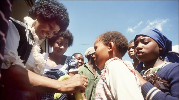 Winnie Madikizela-Mandela returns to the town of Brandfort, where she had been banished by the white government for nine years, to visit local children in 1986.