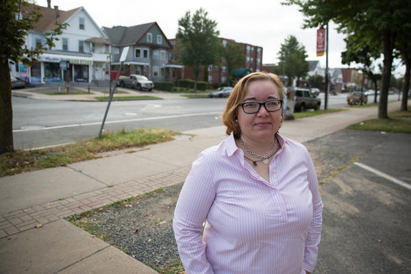 Annette Medero stands outside of the nonprofit she works at in Hartford, Connecticut.