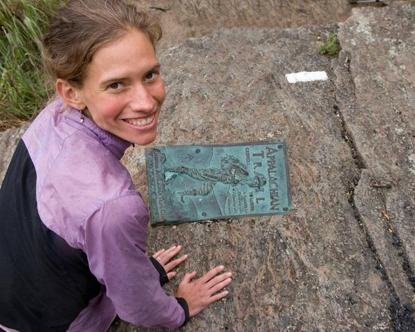 For Jennifer Pharr Davis, the Appalachian Trail has become a pivotal part of her life. Here she lays her hands by the plaque marking the end of the trail that runs through 14 states.