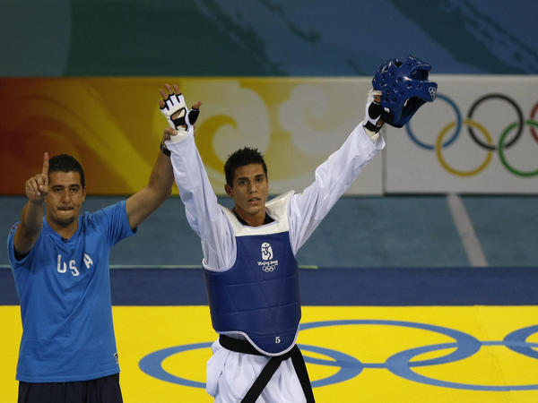U.S. coach Jean Lopez and his brother Steven celebrate after Steven defeated Rashad Ahmadov of Azerbaijan, winning him a bronze medal in the 2008 Beijing Olympic Games.