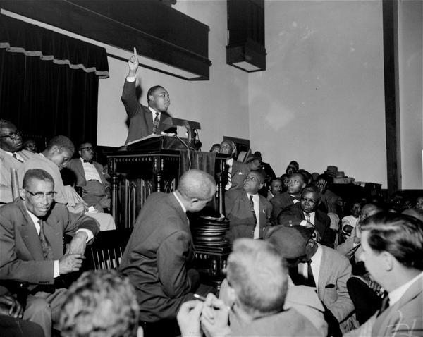 King speaks to an overflow crowd at the Holt Street Baptist Church. King, leader of the Montgomery bus boycott, was found guilty March 22, 1956, of conspiracy in the boycott. (Gene Herrick/AP)