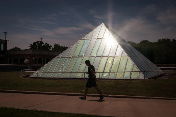 A student walks through the University of Missouri-St. Louis' campus last spring. The college is proposing eliminating and consolidating some academic programs.