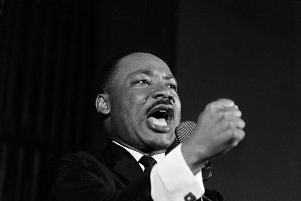 Dr. Martin Luther King Jr. shakes his fist during a speech in Selma, Ala., Feb. 12, 1965. King was engaged in a battle with Sheriff Jim Clark over voting rights and voter registration in Selma. (Horace Cort/AP)