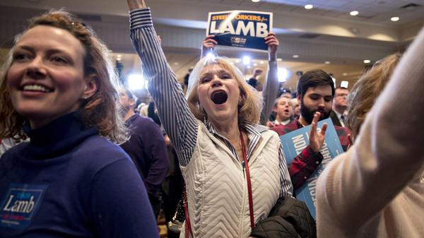 Supporters cheer at an election night rally in Canonsburg, Pa., for Democrat Conor Lamb, whose victory got a boost from suburban voters.