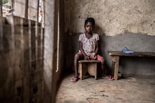 Adama, age 5, was rescued from the mudslide by her brother-in-law. Both her parents died in the disaster. She's now living in a house rented by her older sister.
