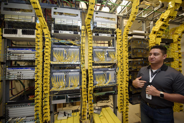 Andrew Gonzales, the telecommunications manager for Kit Carson, in Kit Carson's server room in Taos. He said cost is the biggest barrier for electric co-ops starting their own Internet services.