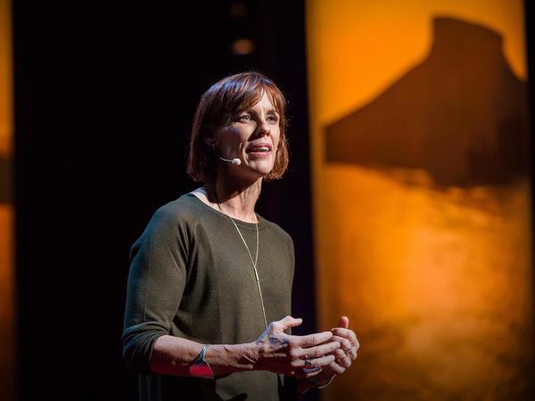 Caroline Paul speaks on the TED stage.