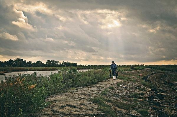 Thomas Gonzales walks the decimated wetlands of southern Louisiana.